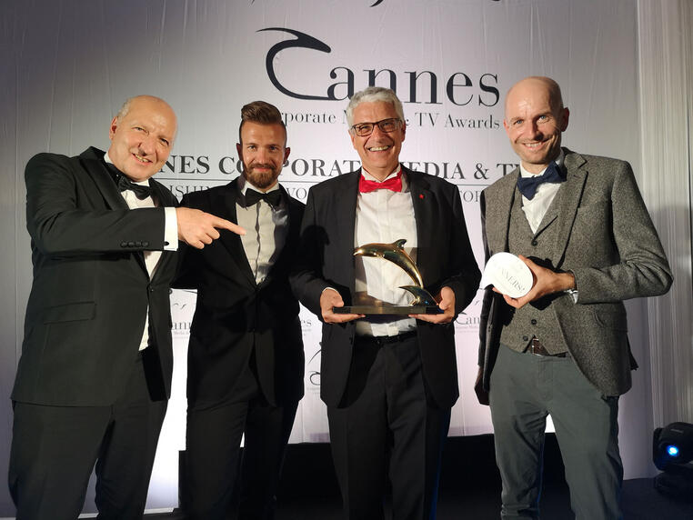 Accepting the Golden Dolphin in Cannes: Peter Beck (Creative Director), Daniel Moreno (Head of Corporate Branding), Jean-Pierre Neuhaus (Head of Corporate Communications), Andy Weimer (Post Production)